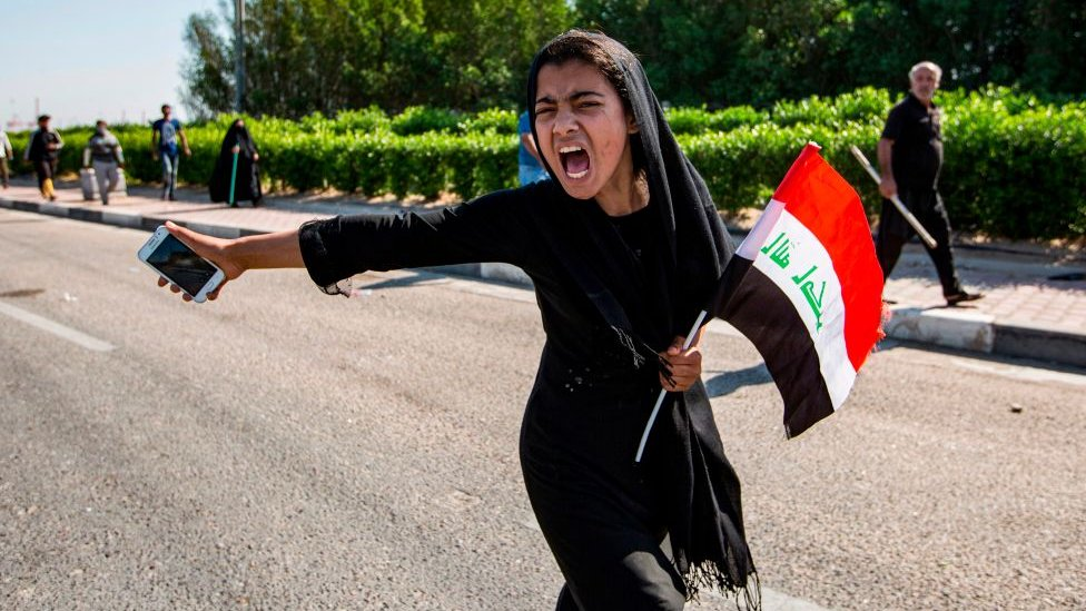 Girl protesting in Iraq
