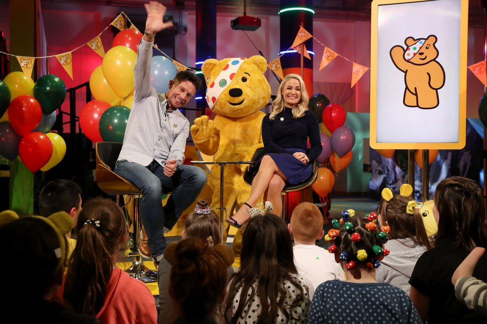 Stephen Clements, Holly Hamilton and Pudsey present the Children in Need show in Belfast