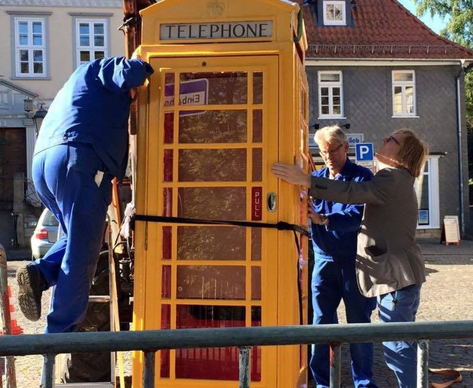 Phone box being moved into place