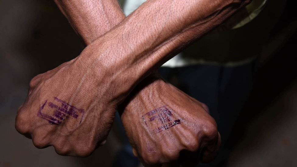 A stamp on a man`s hand
