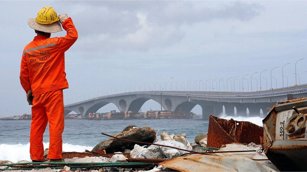 A construction worker looks on as the China-funded Sinamale bridge is seen in Male, Maldives September 18, 2018.