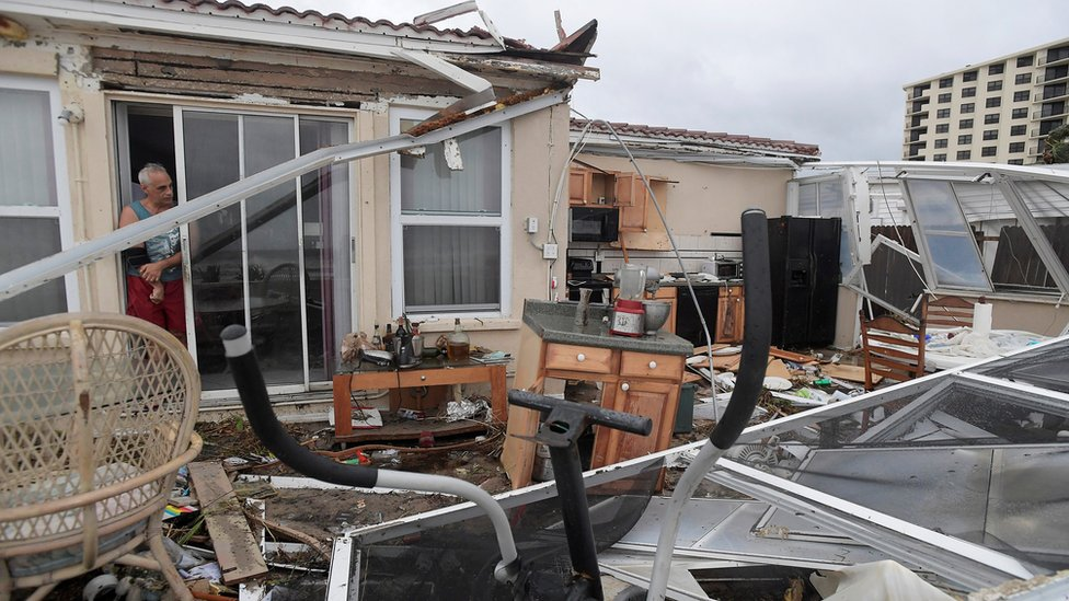 Homeowner Joe Lovece surveys the damage to the kitchen at the back of his home in Ormond Beach, Florida, 7 October.