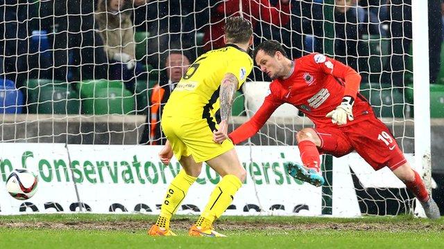 Linfield goalkeeper Ross Glendinning is beaten by Jay Donnelly's strike