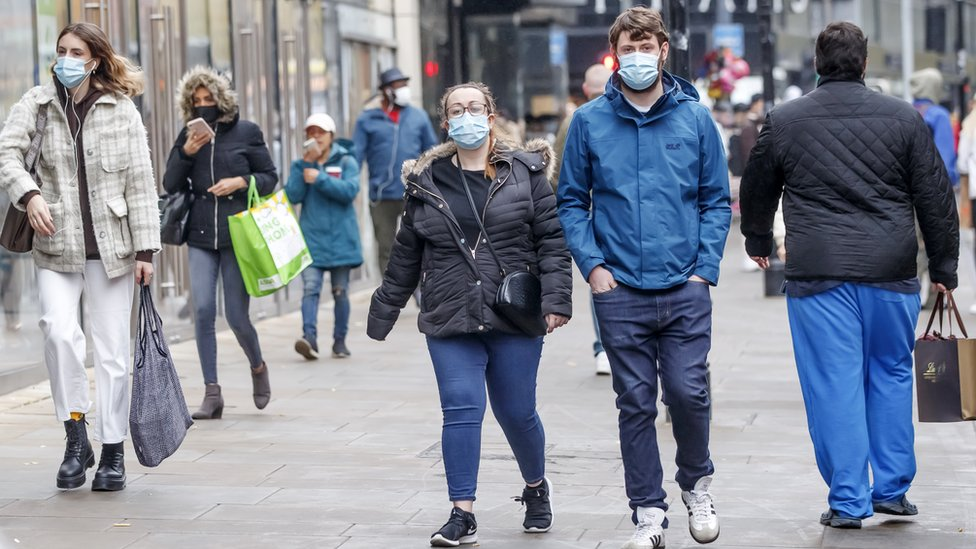 People wear masks in Manchester city centre