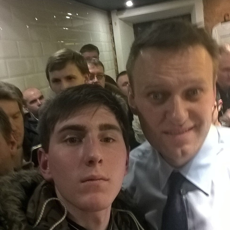 Young Russian protester Pavel Leshev takes a selfie with opposition leader Alexei Navalny