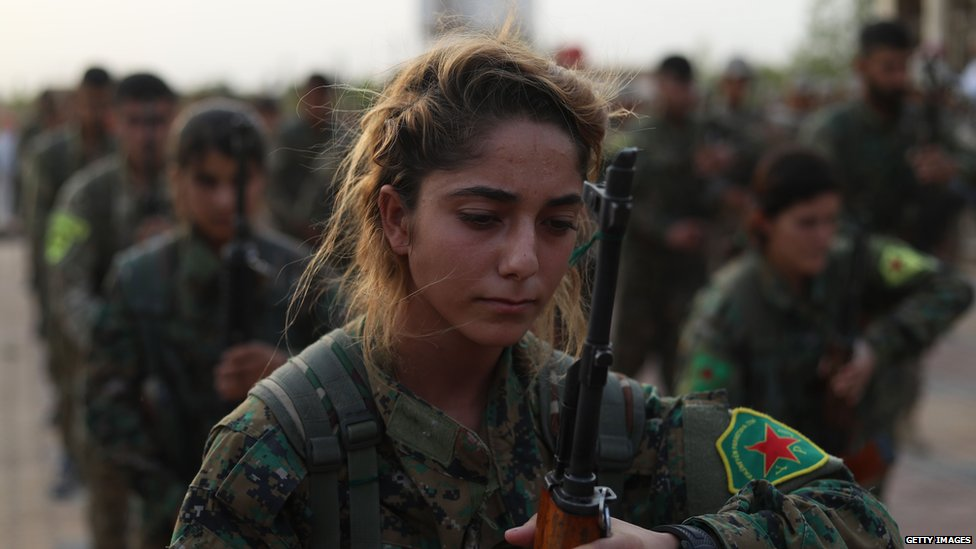 Fighters from the Syrian Democratic Forces attend a funeral of fellow fighters