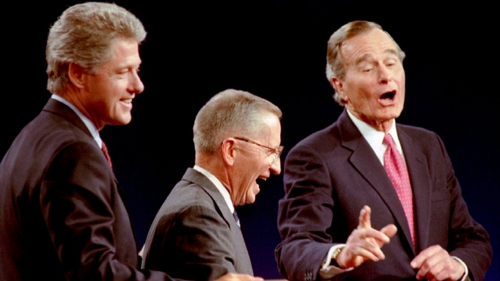 Democrat Bill Clinton (L), Independent Ross Perot (C) and President George Bush during their debate on 19 October 1992