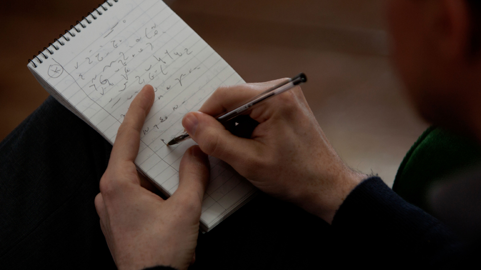 Reporter using shorthand