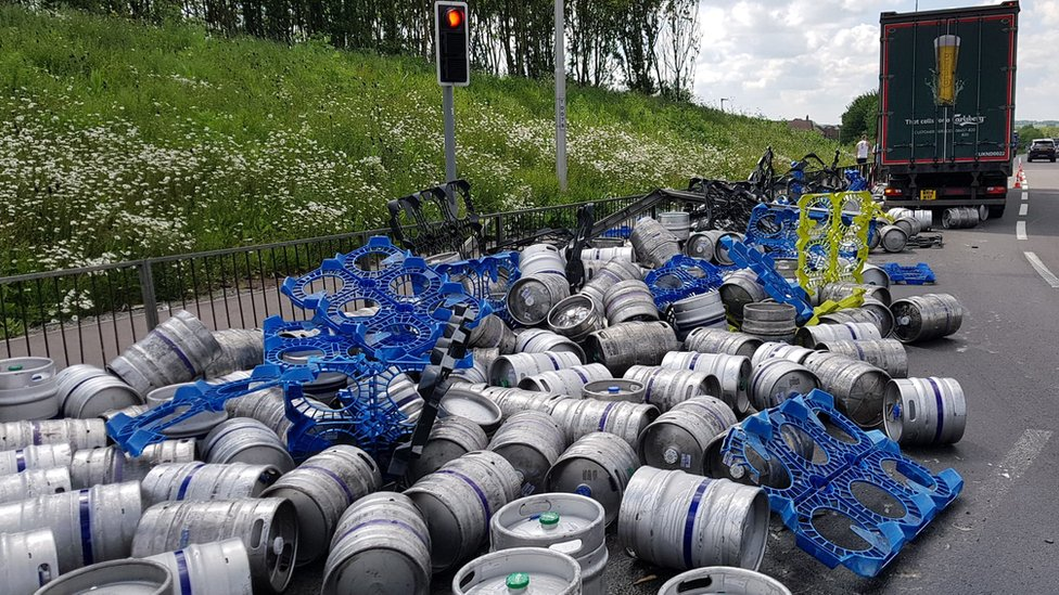 Road blocked as Carlsberg lorry sheds load in Towcester