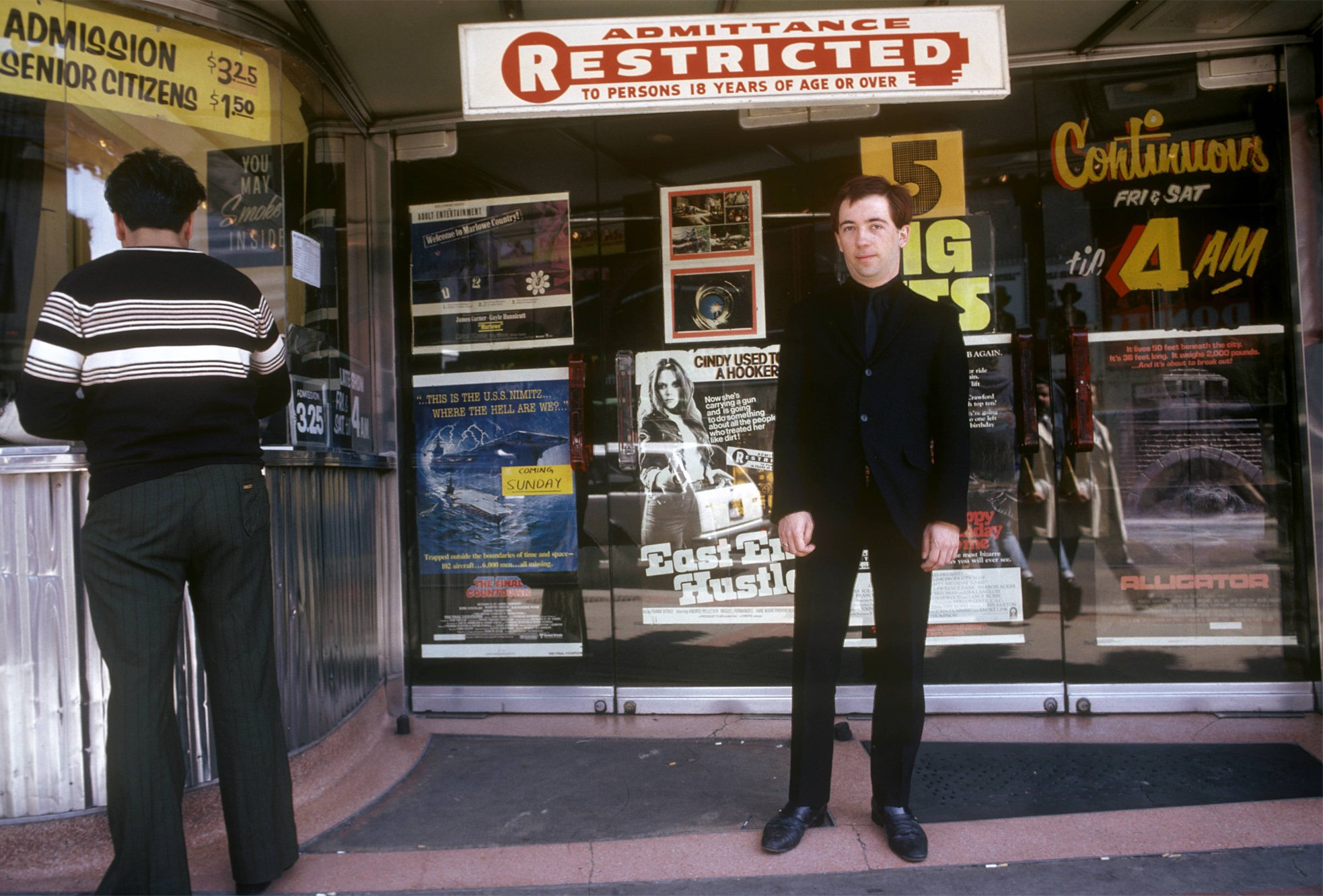 Pete Shelley poses outside a cinema in Canada