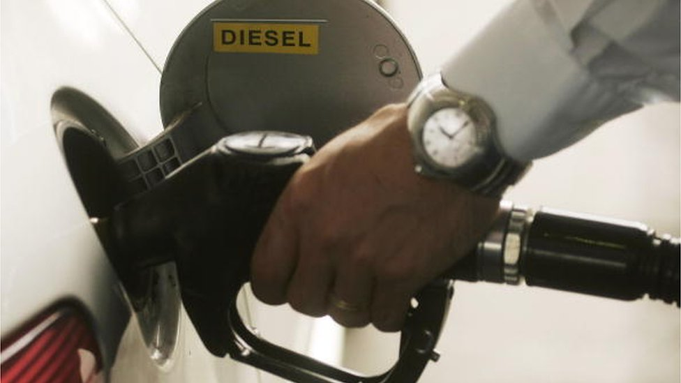 A customer pumps diesel fuel in Luxembourg