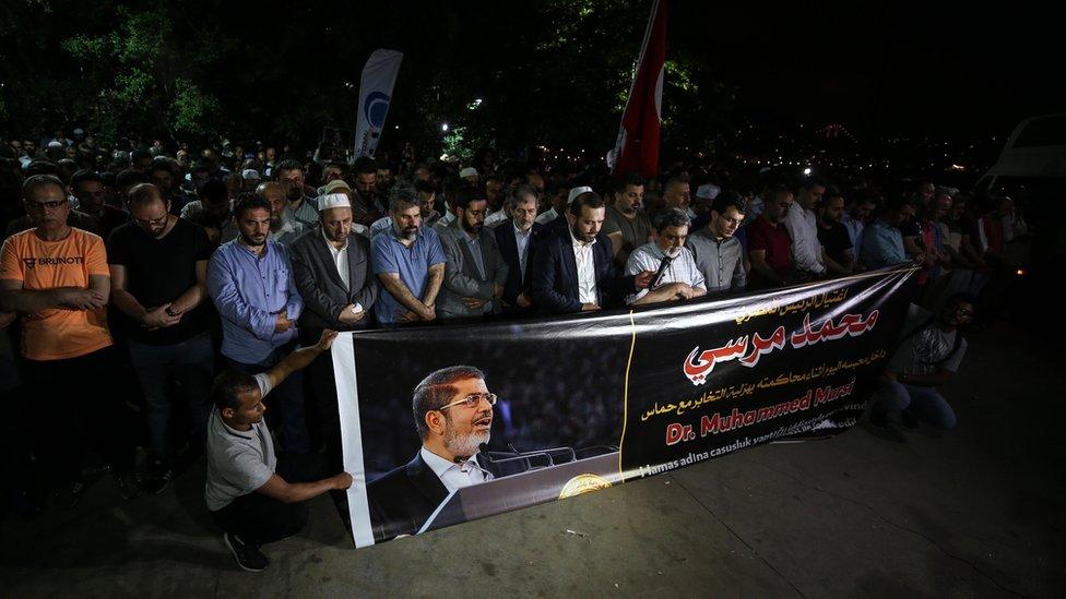 People perform funeral prayer in absentia for former Egyptian President Mohamed Morsi