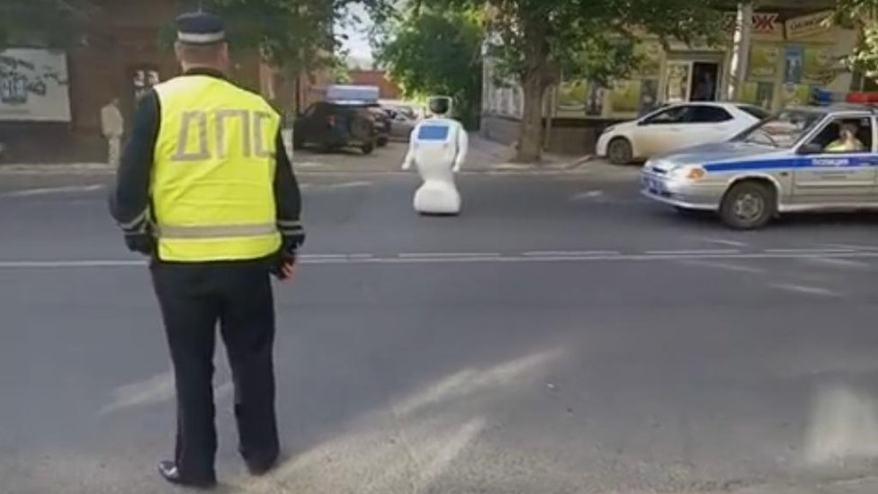 Robot in the middle of a street