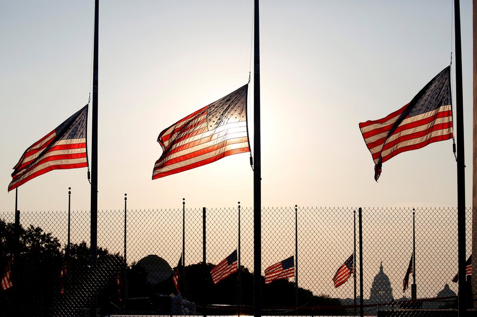 Flags fly at half-staff in honour of Senator John McCain at the Washington Monument in Washington, 26 August 2018