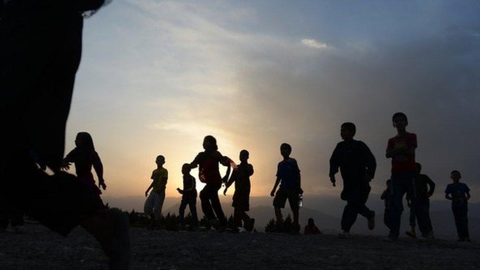 Niños afganos en una ceremonia en la colina Wazir Akbar Khan en Kabul, en septiembre de 2014.