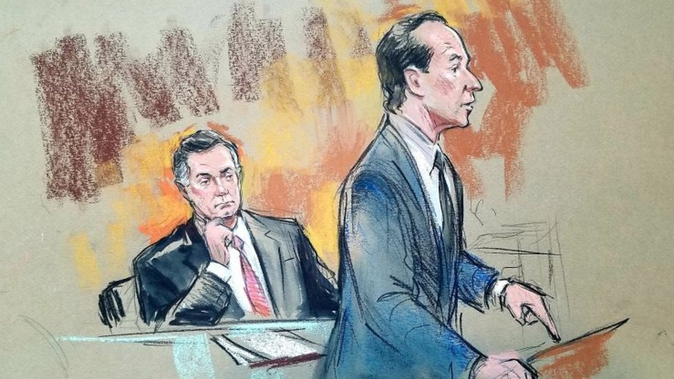 Paul Manafort seated (L) as his attorney speaks in court.