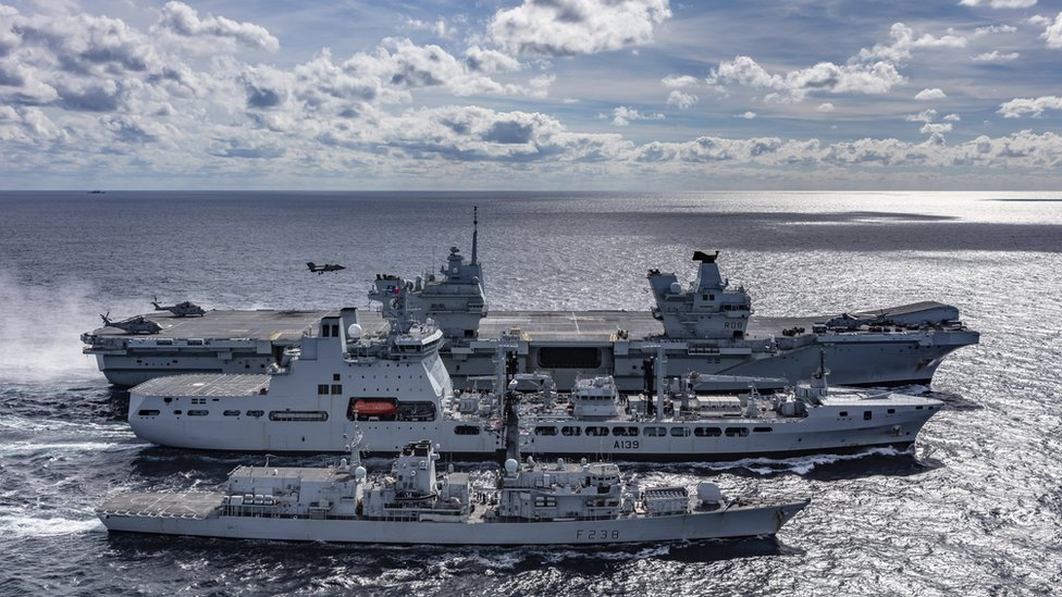 A view of HMS Queen Elizabeth, tanker RFA Tideforce and Type 23 frigate HMS Northumberland in the sea