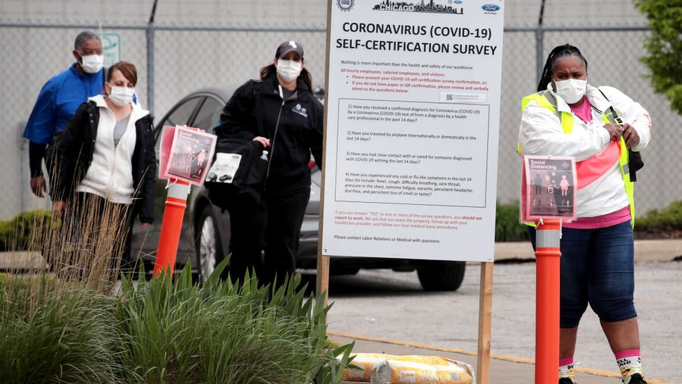 Workers leave Ford's Chicago Assembly Plant on May 20, 2020 in Chicago, Illinois. On Tuesday, one day after reopening the assembly plant, Ford temporarily shut down the facility after two employees tested positive for the coronavirus COVID-19