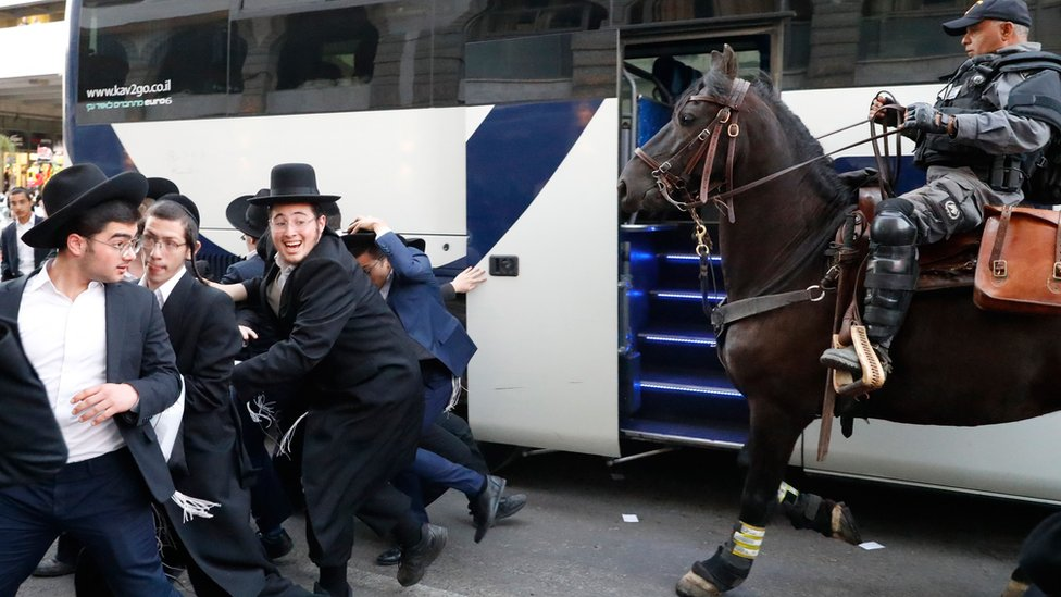 A mounted Israeli policeman disperses a group of Ultra-Orthodox Jews during a demonstration against Israeli army conscription in the Israeli city of Bnei Brak near Tel Aviv on 1 November 2019