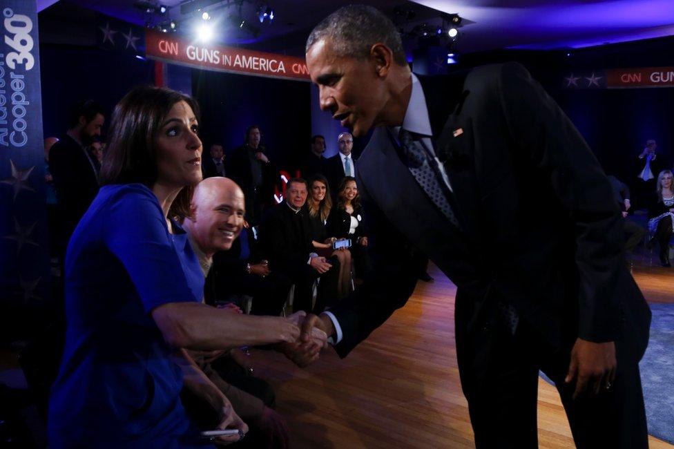 US President Barack Obama greets Taya Kyle, widow of US Navy Seal Chris Kyle in Fairfax, Virginia, 7 January