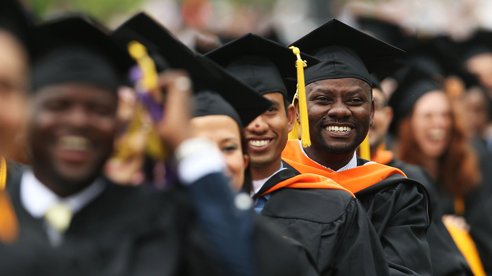 Graduating students participate in commencement exercises at City College on June 3, 2016 in New York City.