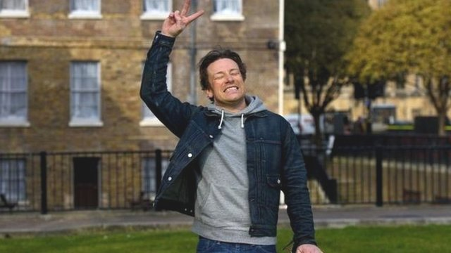 Jamie Oliver celebrates after hearing the news of the Chancellor's sugar tax