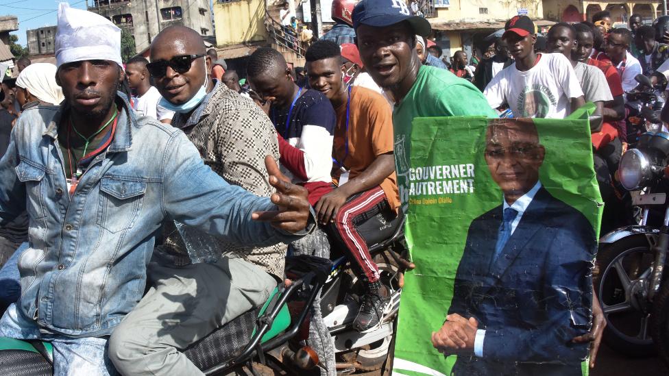 Supporters of Cellou Dalein Diallo on motorbikes in Guinea
