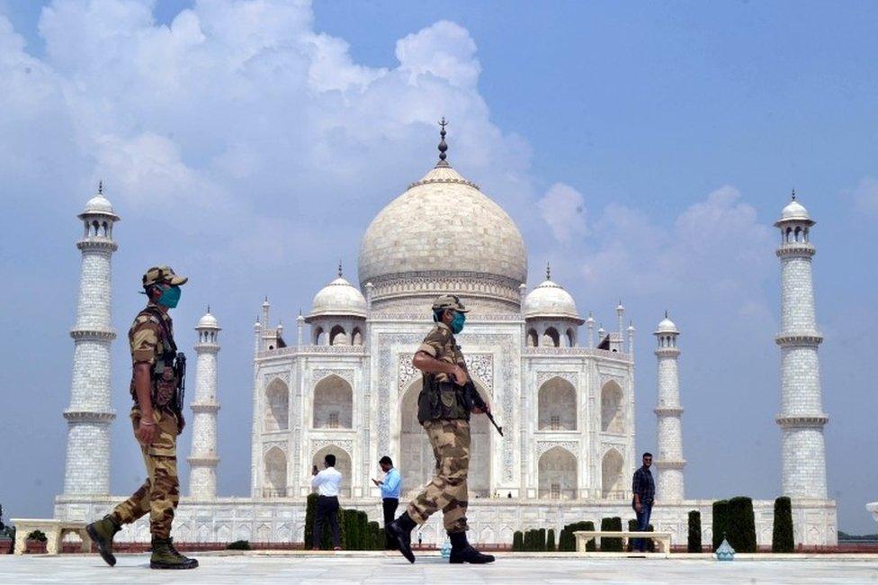 Indian security personnel stand guard at the Taj Mahal in Agra, Uttar Pradesh, India, 21 September 2020
