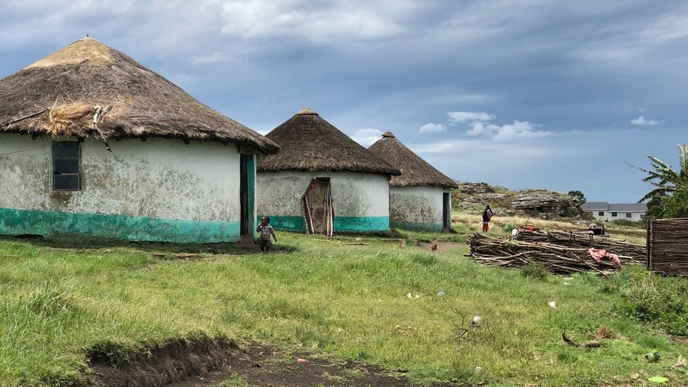 A row of mud huts in Xolobeni, Eastern Cape