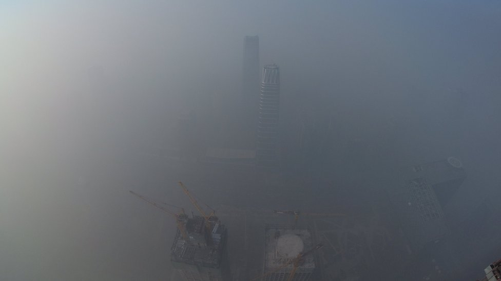 Smog is seen over the city against sky during a haze day in Beijing, China, on 1 January