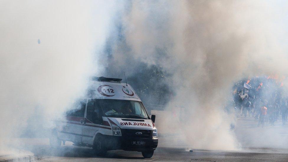 An ambulance driving through tear gas in Ankara after explosions, Turkey, Saturday 10 October 2015