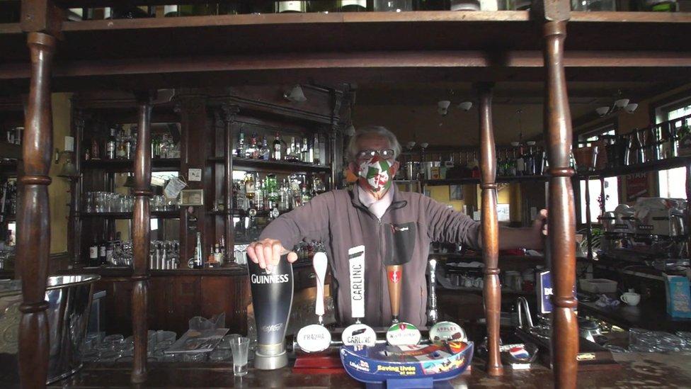 Bob Evans behind the bar