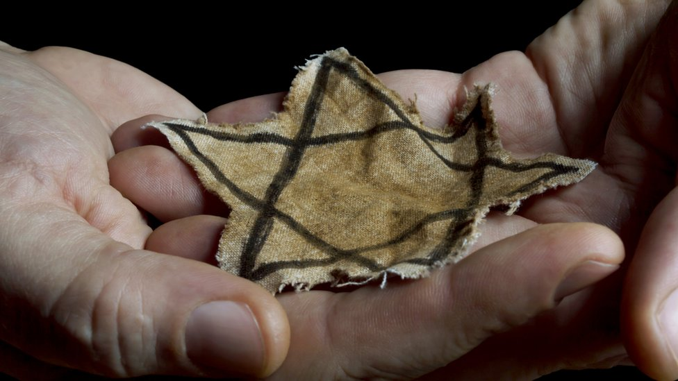 Person holding a Star of David.