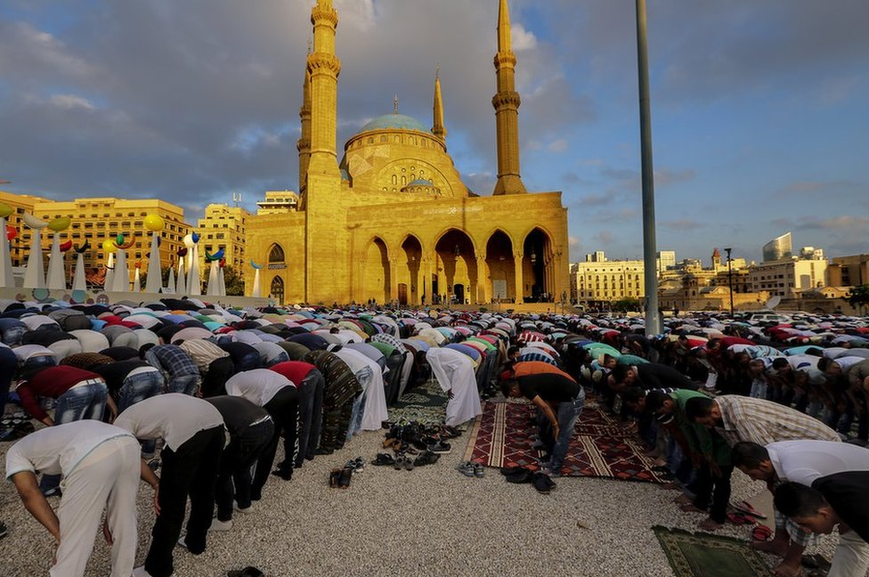 Muslims perform the Eid Al-Fitr prayer outside Al Ameen Mosque in down town Beirut, Lebanon, 15 June 2018