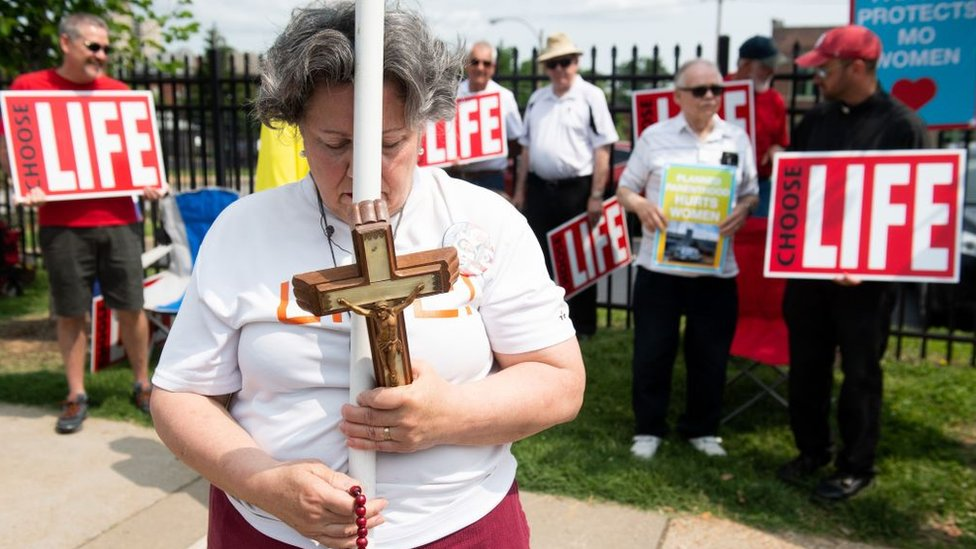 Anti-abortion demonstrators hold a protest outside the Planned Parenthood Reproductive Health Services Center in St. Louis, Missouri, May 31, 2019, the last location in the state performing abortions