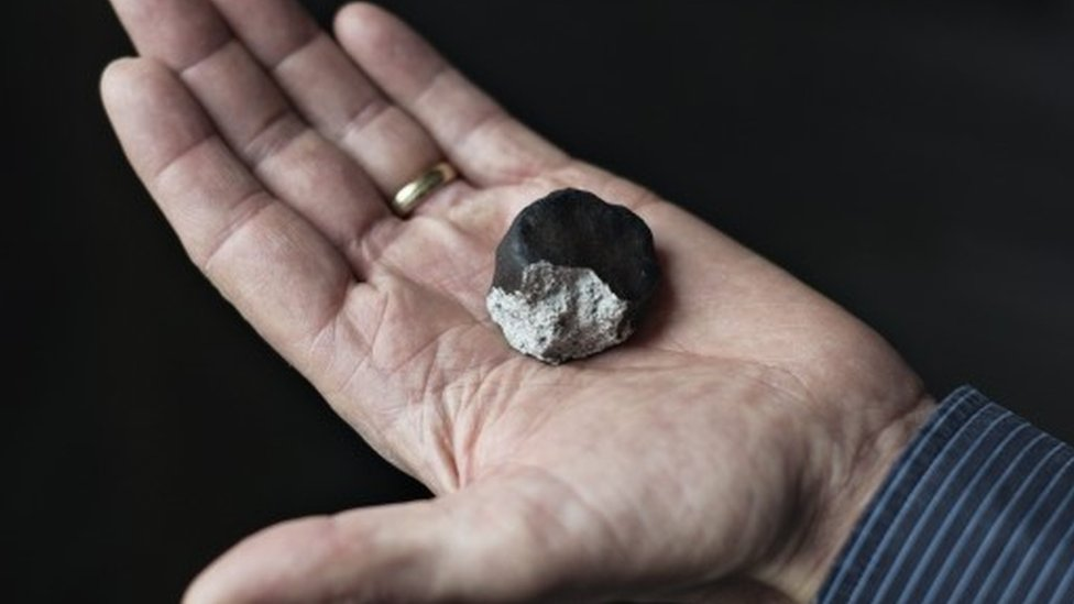 An image dated 08 February 2016 and taken at the Museum of natural History in Copenhagen, showing a fragment of a meteorite which flew over Denmark late 06 February 2016.
