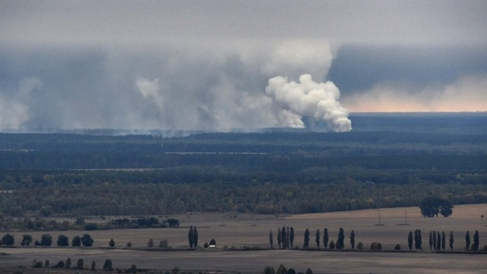 Smoke rises after an explosion at an arms depot in Ukraine