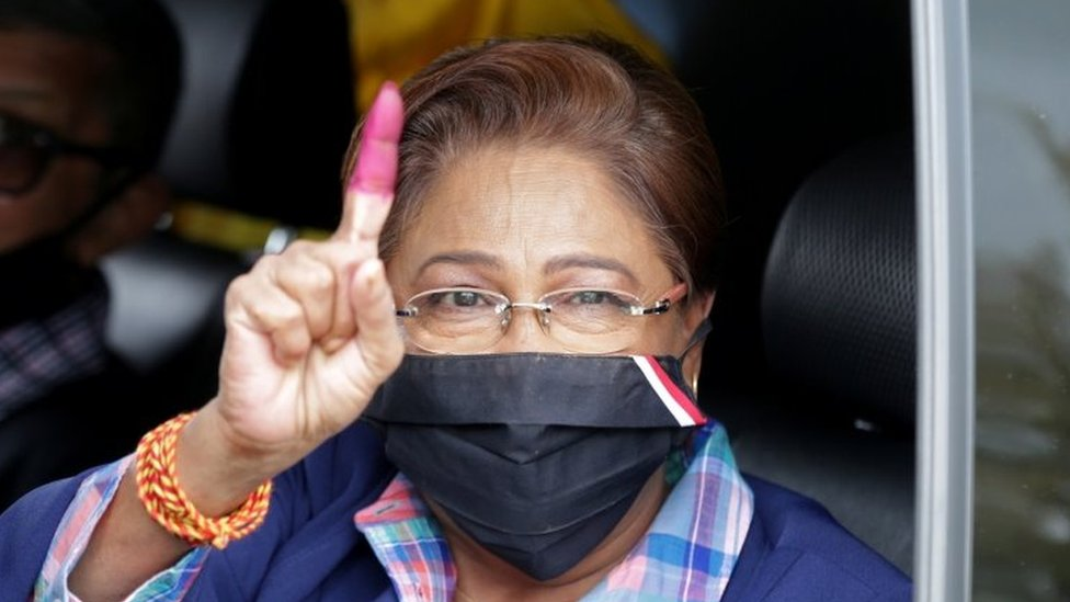 """Trinidad and Tobago""""s former prime minister Kamla Persad-Bissessar from the opposition United National Congress (UNC) gestures after casting her vote in a general election in Port of Spain, Trinidad and Tobago, August 10, 2020."""