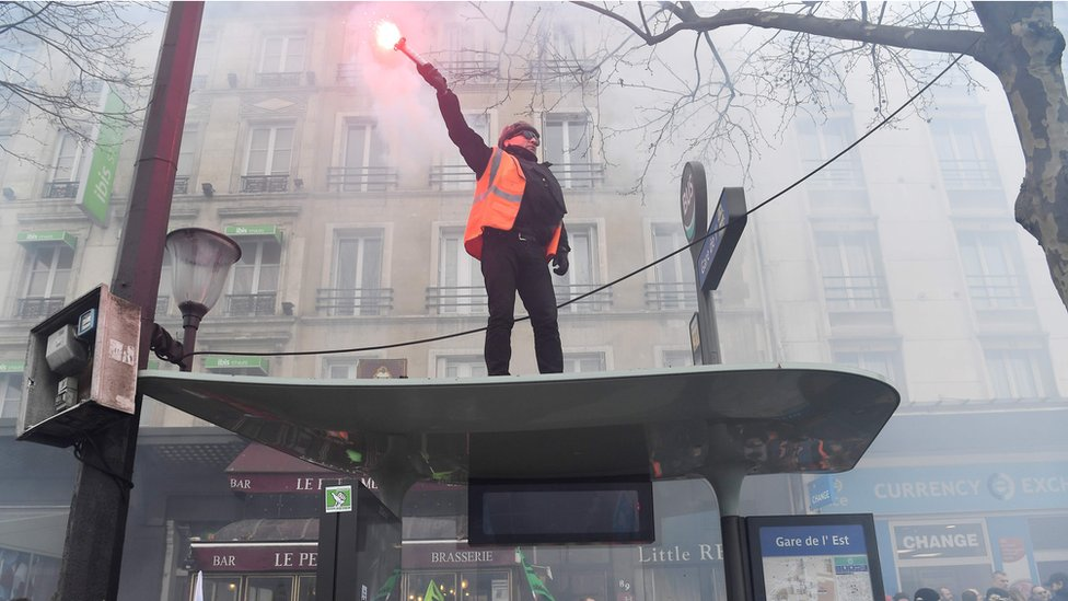 A man with a flare in Paris