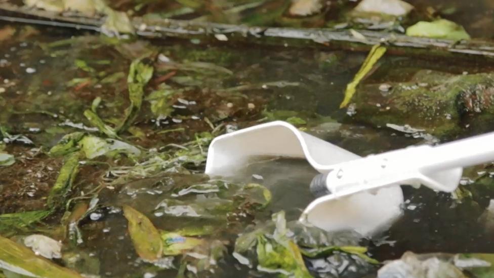 Screengrab of trash in the Tullahan River