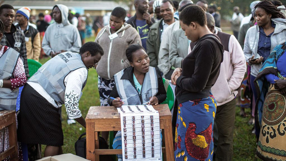 A Malawian Electoral Commission officer checks the voters roll before opening voting stations during general elections on May 21, 2019