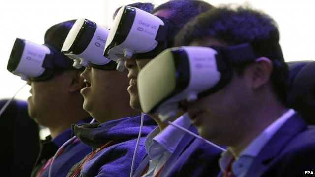 """Visitors try Samsung""""s Gear VR virtual-reality goggles shown at the Mobile World Congress in Barcelona"""