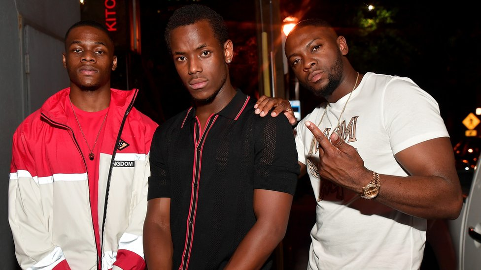 The film's stars, Stephen Odubola (left) and Micheal Ward (centre) with Rapman (right)