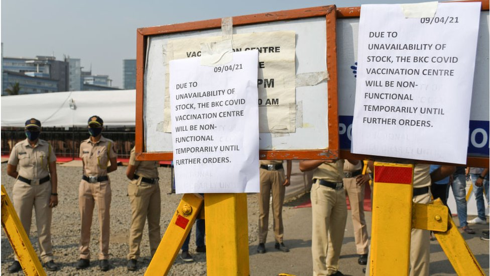 Unavailability of vaccine stock posters outside Bandra Kurla complex jumbo vaccination centre in Mumbai