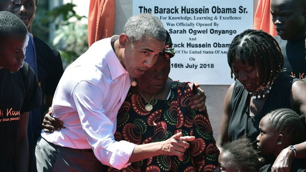 Former US President, Barack Obama (3rdL) with his step-grandmother Sarah (C) and half-sister, Auma (2ndR) and some of the local youth are pictured on July 16, 2018 following the unveiling of a plaque during the opening of the Sauti Kuu Resource Centre, founded by his half-sister, Auma Obama at Kogelo in Siaya county, western Kenya.
