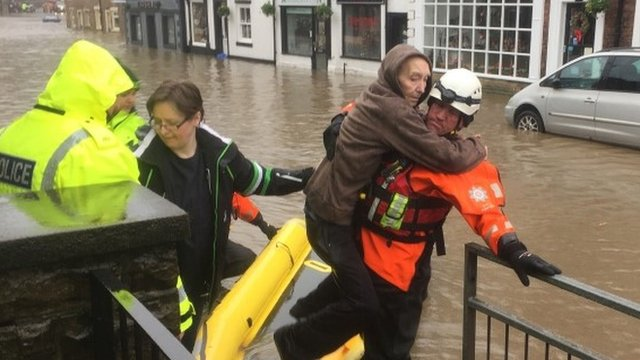 Rescue teams in Whalley, Lancashire, as Lancashire and Yorkshire have been hit by downpours