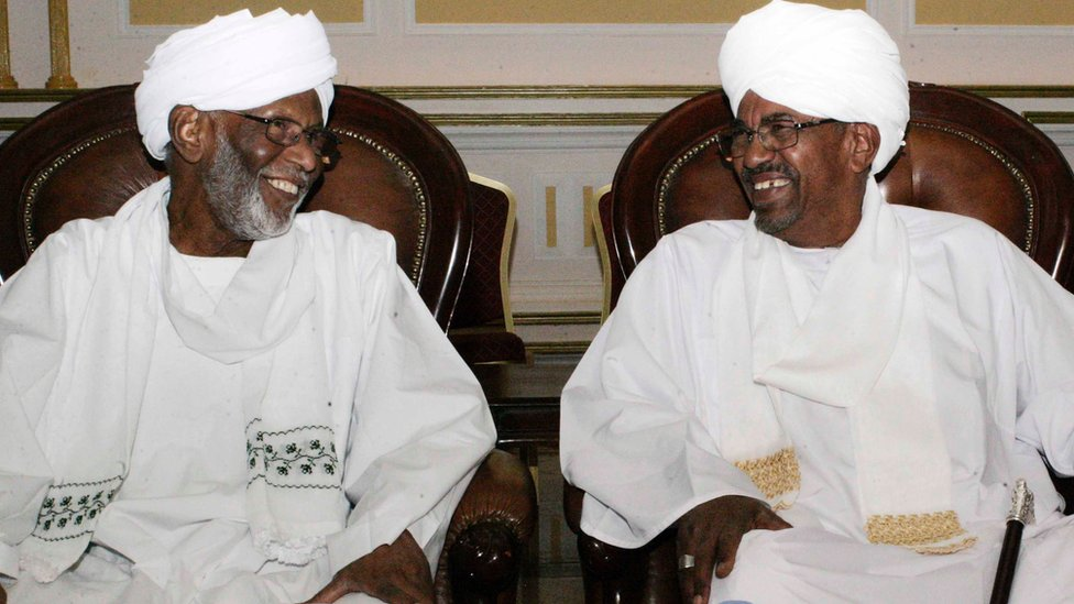 Hassan al-Turabi (left) with President Omar al-Bashir in Khartoum, 14 March 2014
