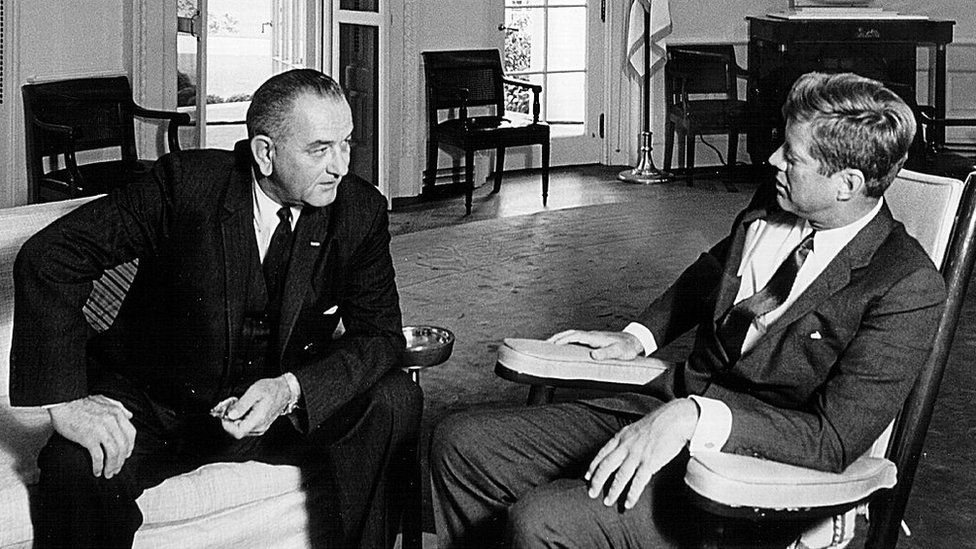 John F Kennedy, right, meets with Lyndon B Johnson in the Oval Office