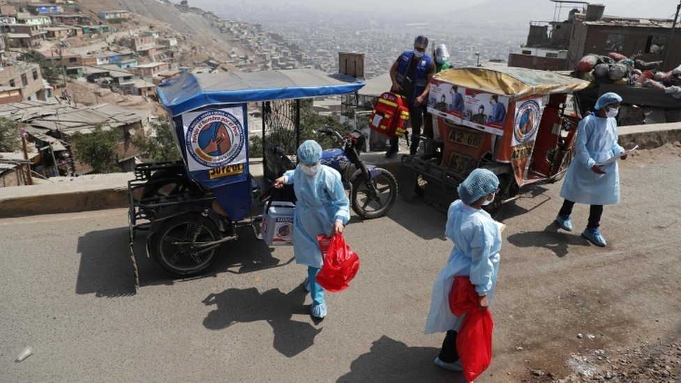 Mototaxi carrying medical personnel in a suburb of Lima - 14 May
