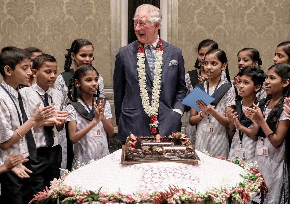 Prince Charles celebrates his birthday with schoolchildren from the Kaivalya Education Foundation during his visit to Mumbai, India.